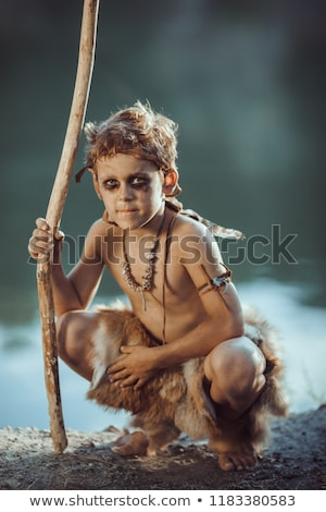Cute caveman, manly boy with staff hunting outdoors. Ancient warrior Stock photo © artfotodima