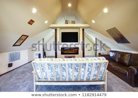Chic attic living room with sloped ceiling. Stock photo © iriana88w