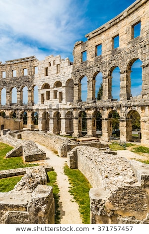 arena pula historic roman amphitheater arches and detail view stock photo © xbrchx