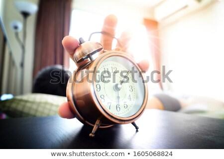 Man Sleeping On Bed Turning Off Clock Stock photo © AndreyPopov