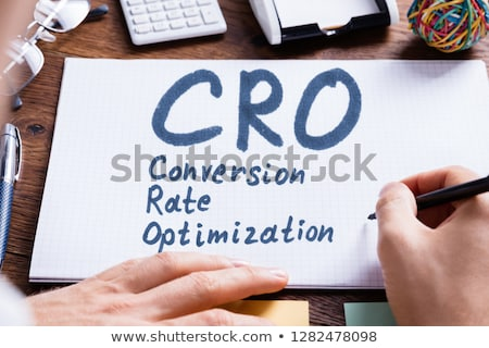 Person Writing Conversion Rate Optimization On Book Stock photo © AndreyPopov