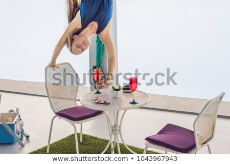 Woman upstairs on the table ready for dinner Stock photo © galitskaya