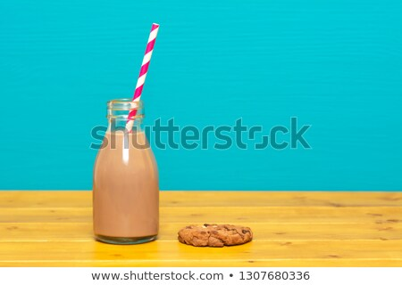 chocolate milkshake in a milk bottle and a chocolate chip cookie stock photo © sarahdoow