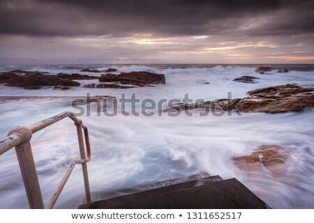 Coastal pool overflow in big seas Stock photo © lovleah