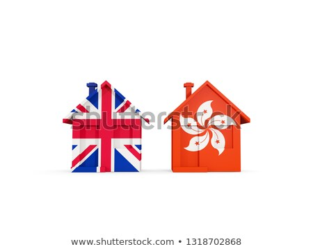Two houses with flags of United Kingdom and hong kong Stock photo © MikhailMishchenko