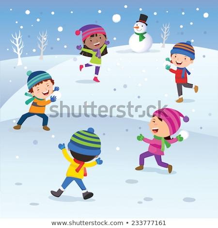 children kids playing snowballs at wintertime stock photo © robuart