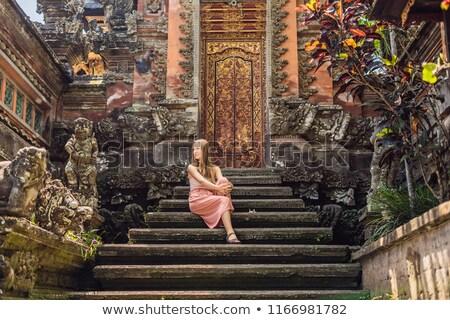 Young woman traveler in the background of Pura Taman Kemuda Saraswati Temple in Ubud, Bali island, I Stock photo © galitskaya