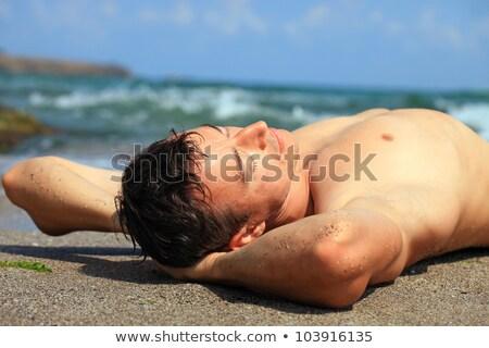 Közelkép portré izmos férfi tengerparti homok fickó Stock fotó © majdansky