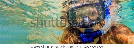Woman snorkeling in tropical waters in front of exotic island BANNER, long format Stock photo © galitskaya
