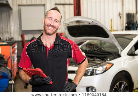 Сток-фото: Handsome Mechanic Based On Car In Auto Repair Shop With Tablet On Hand