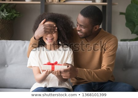 birthday girl receiving present brother with gift stock photo © robuart