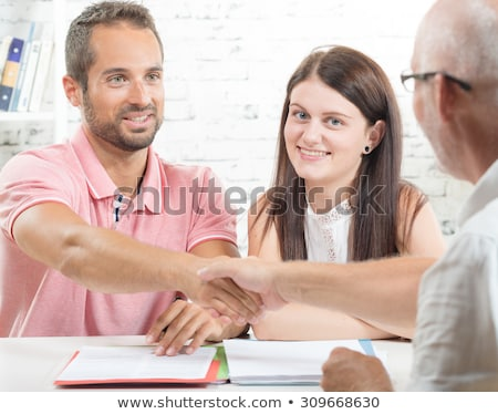 young man shaking hands with an insurance agent or investment ad stock photo © snowing