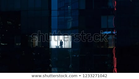 Businessman working late hours in the office Stock photo © Elnur