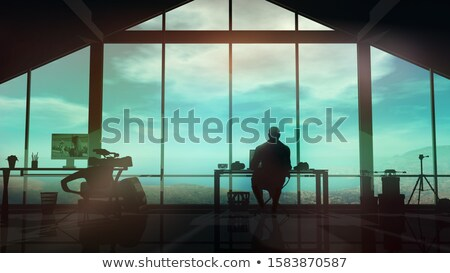 In a film studio the silhouette of a videographer at the desk. Stock photo © ConceptCafe