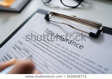 Title Insurance Form Over White Desk Stock photo © AndreyPopov