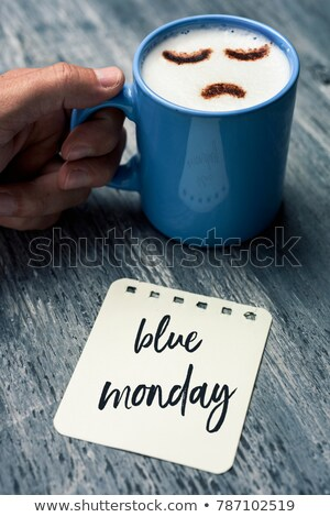 man and cup of coffee with the text blue monday