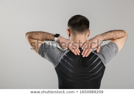 Image from back of athletic sportsman standing while working out Stock photo © deandrobot