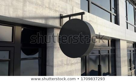 Round Black Sign Outside Shop Facade Stock photo © albund