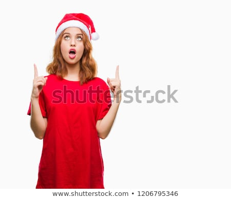 Stock photo: young redhead woman wearing santas hat