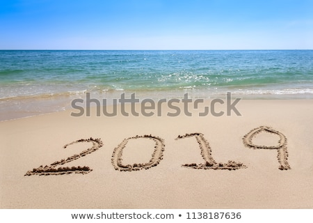 Relax, written on a sandy beach. Stock photo © latent
