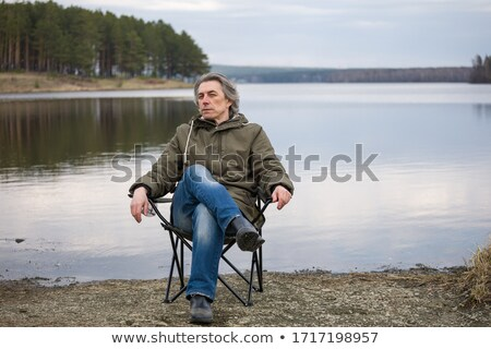 Travelling macho at the river shore Stock photo © pekour