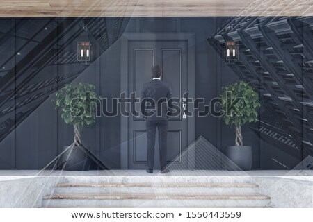 businessman standing outside a modern house stock photo © photography33