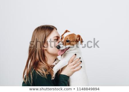 Cute women with dog smiling Stock photo © konradbak