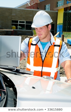Handsome tradesman using a laptop Stock photo © photography33