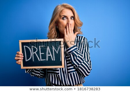 Woman silently holding message board Stock photo © photography33