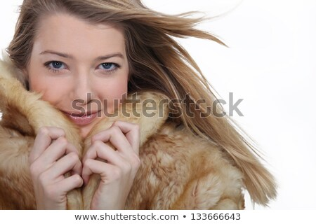 Woman snuggling up to a fur coat Stock photo © photography33