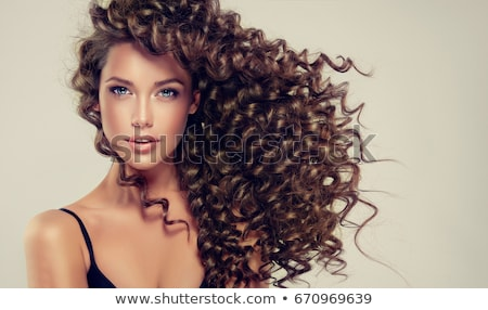 woman with long brown curly hair stock photo © lubavnel