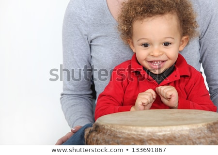 Little boy sat by bongo drum Stock photo © photography33