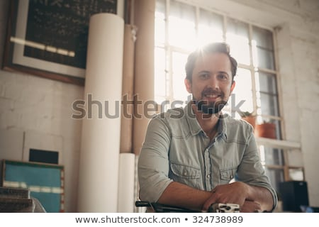 craftsman looking through a window frame stock photo © photography33