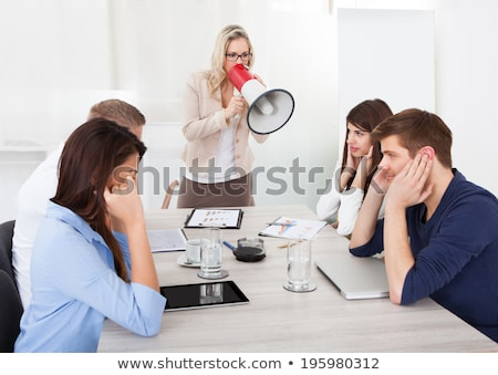 Angry businessman shouting through megaphone Stock photo © photography33