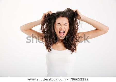 Emotional girl brunette pulling her hair Stock photo © gromovataya