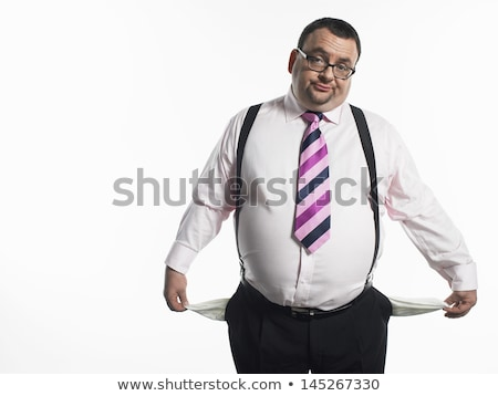 portrait of a businessman with empty pockets against white babckground stock photo © wavebreak_media