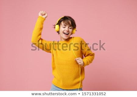 jonge · vrouw · hoofdtelefoon · mooie · gelukkig · meisje · vrouw · glimlachen - stockfoto © kyolshin