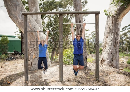 fit man performing pull ups in a bar Stock photo © dacasdo