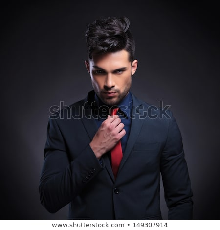crooked casual man fixes his tie Stock photo © feedough