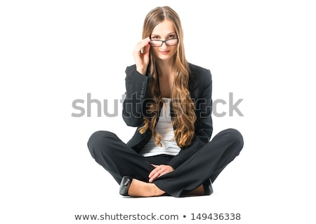 Young business woman with glasses scrutinizing Stock photo © Kzenon
