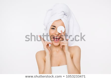 Beautiful woman using a cotton pad to remove her makeup Stock photo © Nobilior