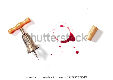 cork and corkscrew with red wine stains stock photo © karandaev