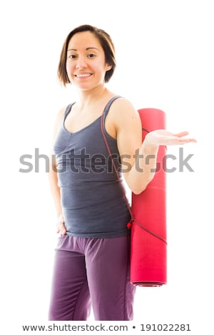 Young woman carrying exercise mat showing something and smiling Stock photo © bmonteny