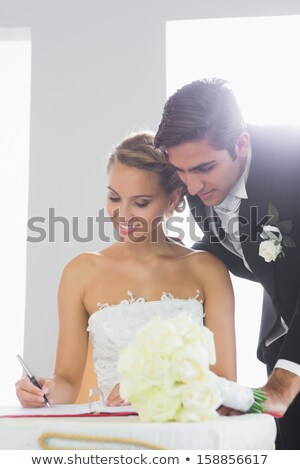 beautiful blonde smiling bride signed contract Stock photo © artush