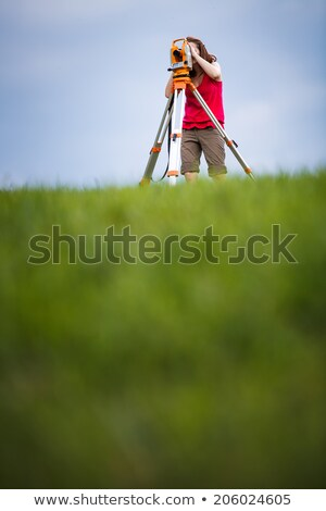 Young, female land surveyor at work - using the theodolite level Stock photo © lightpoet