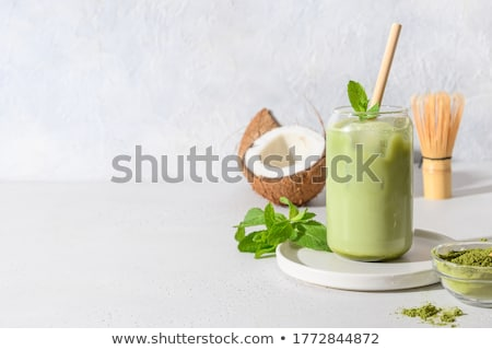 glass of ice green tea cube drink stock photo © nalinratphi