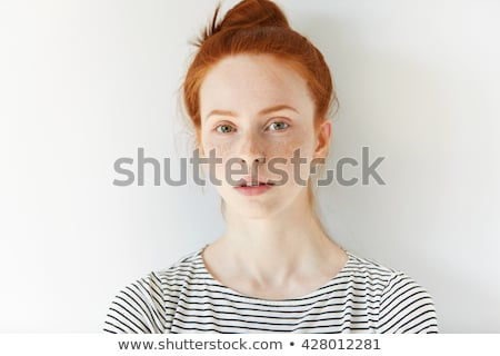 portrait of a serious young girl with fresh skin on blue background stock photo © deandrobot