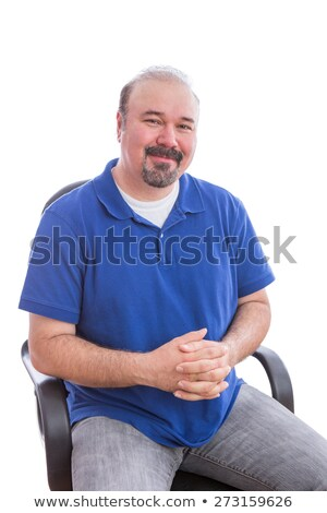 Admiring Bearded Man on a Chair Looking at Camera Stock photo © ozgur