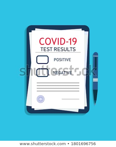 Doctor writing patient test results on board Stock photo © HASLOO