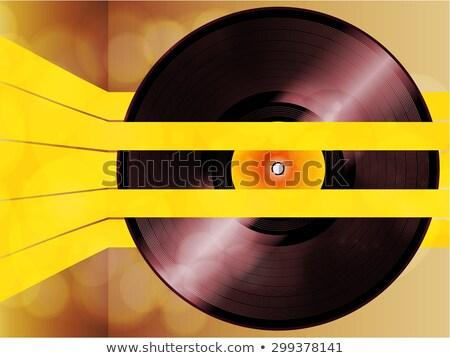 Vinyl record glowing on yellow stripes Stock photo © elaine